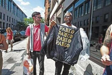 Boston, MA., 08/19/16, Jon Sherman, left, and Kobla Hargett, cq, of Boston, showed off their merchandise. A Kanye West popup store on Boylston Street had fans lined up around the block and into an alley. Suzanne Kreiter\Globe staff